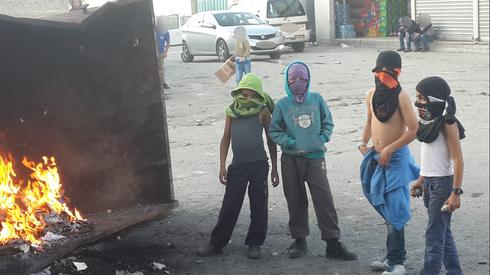 Children in a Palestinian refugee camp near Jerusalem