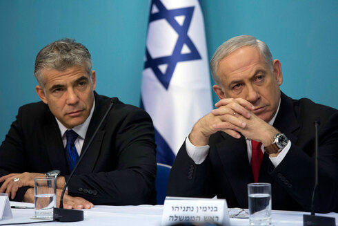 Then-Finance Minister Yair Lapid and Prime Minister Benjamin Netanyahu