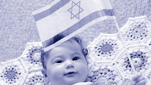 A baby holding Israeli flag
