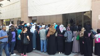 People congregating outside the unemployment bureau in Be'er Sheva during coronavirus outbreak