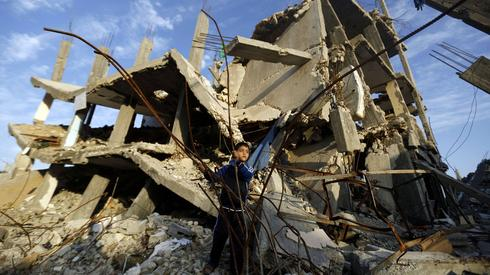 A Palestinian child in the rubble in Gaza during the 2014 war