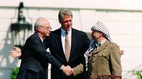 Prime Minister Yitzhak Rabin, President Clinton and Yasser Arafat sign the Oslo Accords at the White House