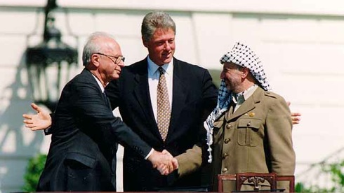 Prime Minister Yitzhak Rabin, U.S. President Bill Clinton and PLO Chairman Yasser Arafat during the signing of the Oslo Accords at the White House in 1993