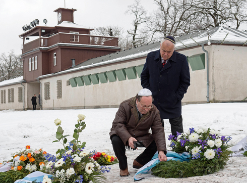 Local Jews in Thuringia place flowers at the mass graves during Holocaust Remembrance Day