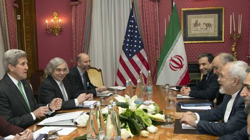 Then-U.S. Secretary of State John Kerry and Iranian Foreign Minister Mohammad Javad Zarif during the 2015 nuclear deal talks