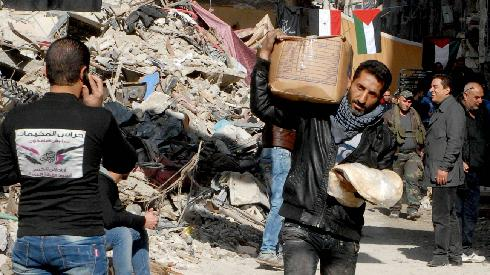Palestinians in the Yarmuch Refugee Camp near Damascus