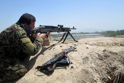 Afghan security forces soldier firing at Taliban positions