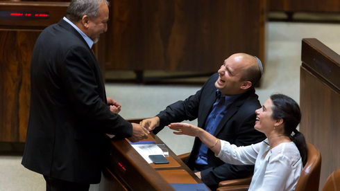 Avigdor Liberman with Naftali Bennet and Ayelet Shaked in the Knesset in 2015