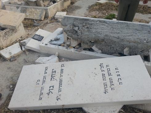 The desecration of graves at the Jewish cemetery on the Mount of Olives in Jerusalem