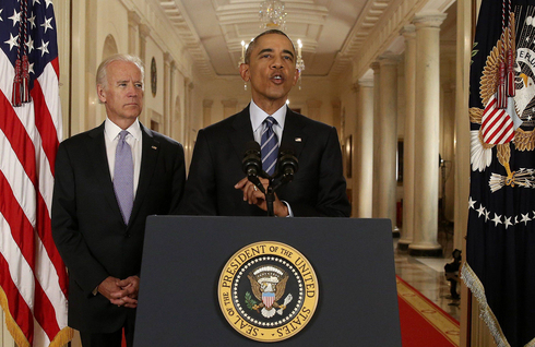 Then-vice president Joe Biden watches as President Barack Obama announces the Iran nuclear deal, July 2015
