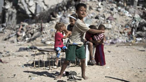 Palestinian children in the rubble in Gaza during the 2014 war