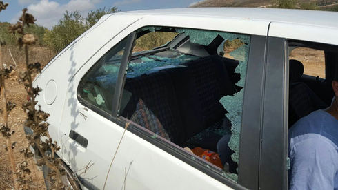 A Palestinian farmer's car is vandalized during a 2020 attack on olive farmers by Yitzhar settlers