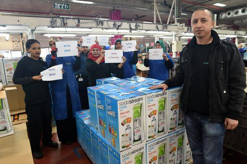 Arab workers at the now shuttered West Bank SodaStream plant