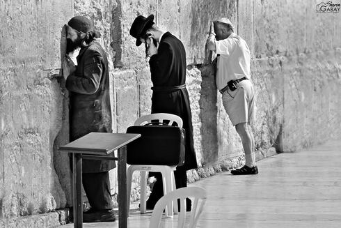 Secular and Haredi Jews praying side by side at the Western Wall in Jerusalem