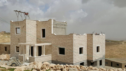 A Palestinian home under construction south of Hebron