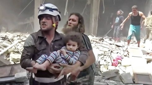 Civilians run from bombs in Aleppo in 2016 during the Syrian civil war