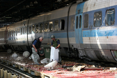 The aftermath of a Hezbollah missile strike on a train in Haifa during the 2006 war