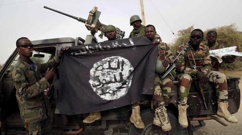 Nigerian soldiers holding a Boko Haram flag