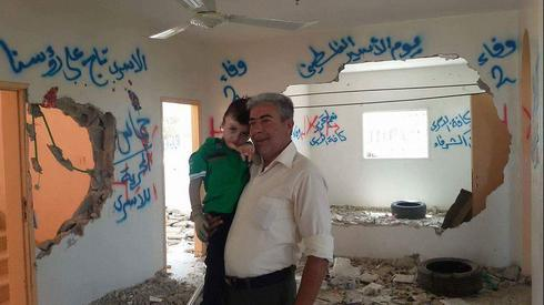 Ahmed Dawabsha who survived the fire, at the house that was attacked