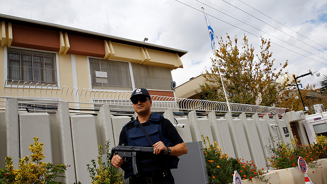 An armed security guard stands outside the Israeli embassy in Ankara