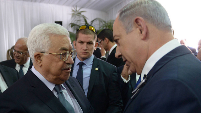 Palestinian President Mahmoud Abbas and Prime Minister Benjamin Netanyahu talk at the 2016 funeral of Shimon Peres, the last time the two met