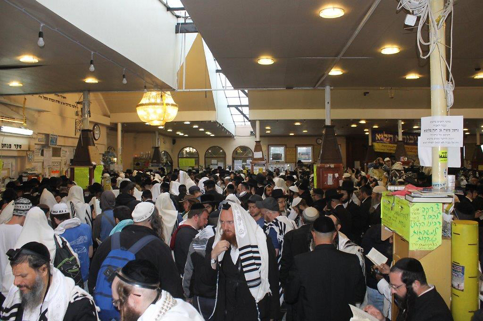 Jews praying at a synoguge near the burial site of Rabbi Nachman of Breslov