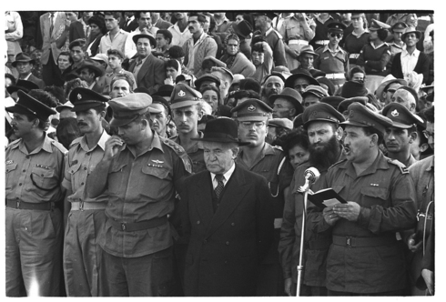 Prime Minister David Ben-Gurion attends a memorial service for soldiers who fell in the Suez Crisis of 1956