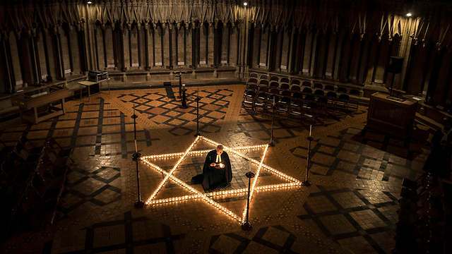 Candles lit in a British church on International Holocaust Remembrance Day