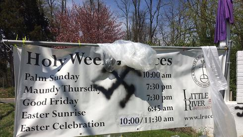 A swastika sprayed on a church banner in Virginia during Easter