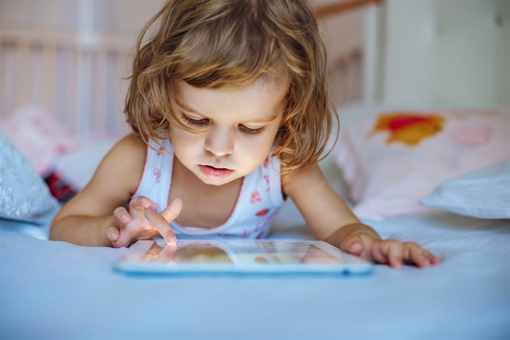 Illustrative: A child with a tablet