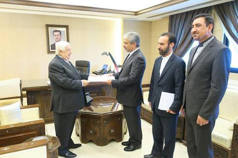 Moallem meeting with Iranian officials in Damascus in 2017