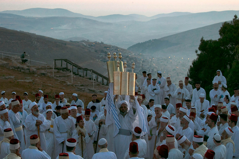 Samaritan worshipers pray on Mount Gerizim as they celebrate the Shavuot festival at dawn, June 2017