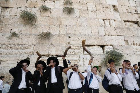 Blowing the shofar at the Western Wall on Rosh Hashanah before the pandemic
