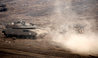 IDF tanks stationed near the border with Syria