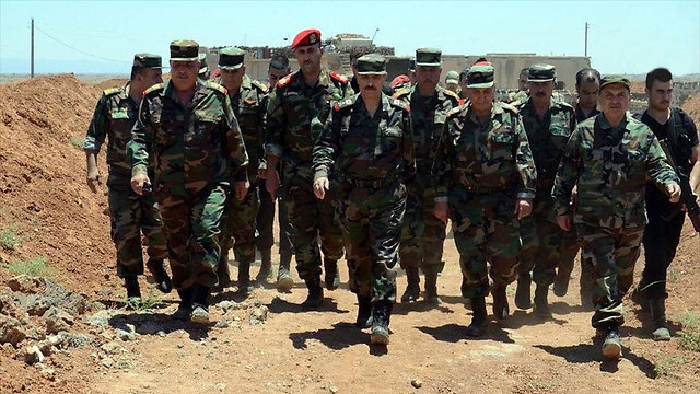 Hezbollah fighters on the Syrian side of the Golan Heights