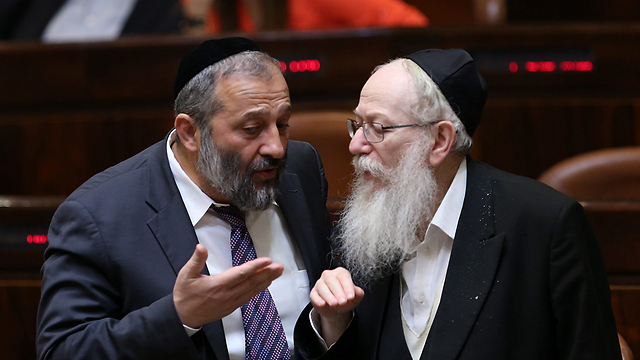 Haredi party leaders Aryeh Deri of Shas, left, and Yaakov Litzman of United Torah Judaism in the Knesset