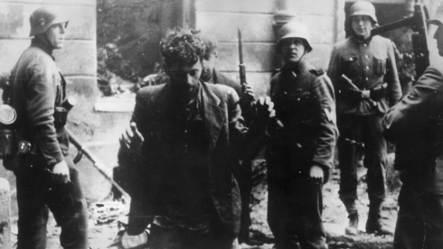 Nazi troops arresting a member of the Jewish resistance in the Warsaw Ghetto in 1943