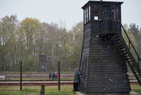 Barbed wire fence and a watchtower are seen at the former Nazi Death Camp Stutthof, in Sztutowo, Poland