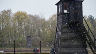 Barbed wire fence and a watch tower are seen at the former Nazi Death Camp Stutthof, in Sztutowo, Poland