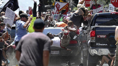 An alt-right fascist plows his car into crowd  of counter-demonstrators in Charlottesville, Virginia in 2017
