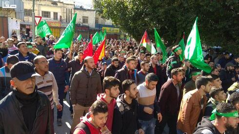 Palestinian and Hamas activists protesting in Nablus over the U.S. recognition of Jerusalem as the capital of Israel