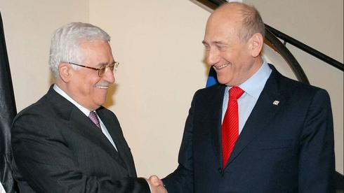 Then-Prime Minister Ehud Olmert meets with Palestinian President Mahmoud Abbas