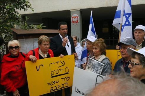 Holocaust survivors protest a bill that would criminalize blaming Poland for Nazi crimes during WWII, in Tel Aviv, February 8, 2018