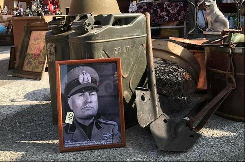 An image of Mussolini on sale in a market in Verona, Italy