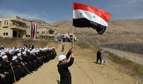 Druze residents of the Golan Heights attend a rally in support of Syrian President Assad in Majdal Shams