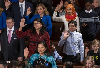 Rep. Rashida Tlaib wears a Palestinian thobe as she is takes her oath on the opening day of the 116th Congress