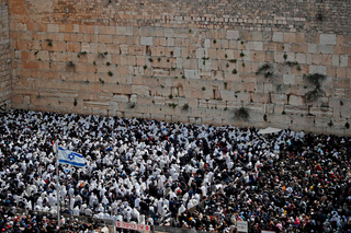 Jews praying at the Western Wall during Passover before the pandemic hit