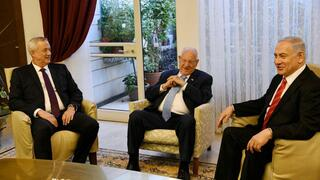 Rivlin with Gantz and Netanyahu during unity government talks in 2019