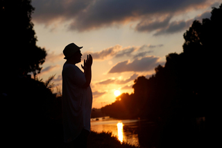 A woman performs Tashlich ceremony of atonement during Rosh Hashanah in Tel Aviv
