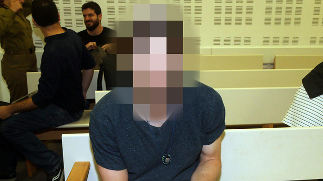 The defendant, who was a minor at the time of the attack, in court